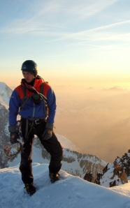 Finn McCann on the summit of the Aiguille Verte.