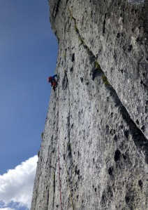Finn McCann leading out on the headwall of The Lotus Flower Tower