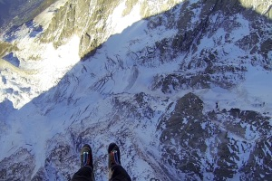 Finn McCann looking down the North Face of the Aiguille du Midi