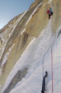 Finn on the thin ice seam that leads up to the crux of the route - a tenuous dry tooling traverse