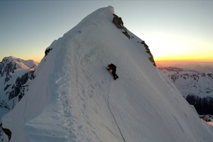 Muzz reaching the summit ridge at sunset