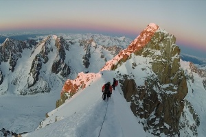 The team descending the ridge to access the Whymper Couloir