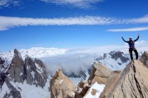 Finn McCann on the summit of the Aguja de Poincenot