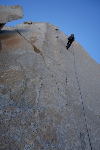Wilki abseiling the upper headwall