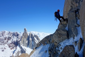 Wilki abseiling with Cerro Torre behind